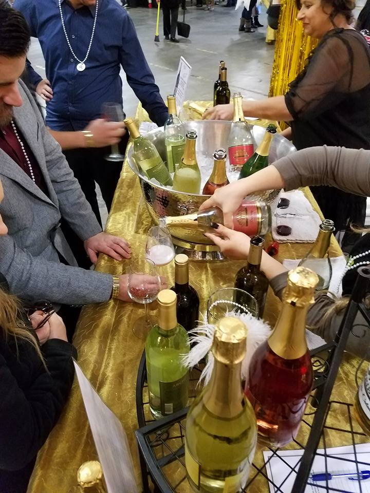 Sparkling being poured at a Club Weibel party