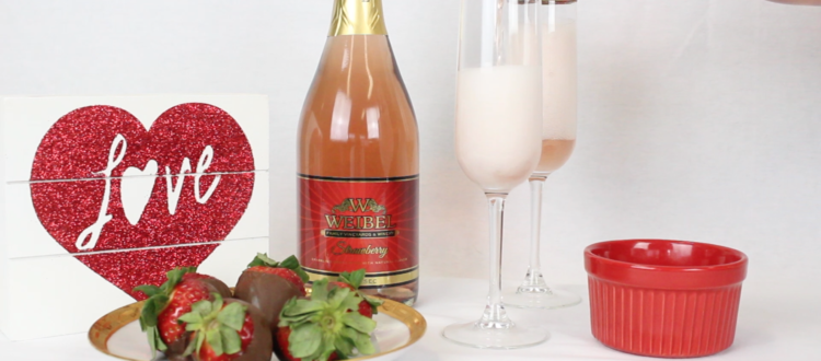 Two Valentines day mimosas, chocolate strawberries, and Weibel Sparkling Strawberry