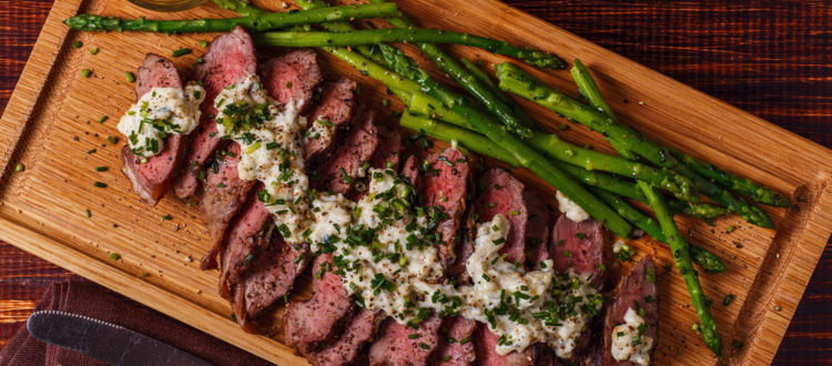 Aerial view of steak and asparagus