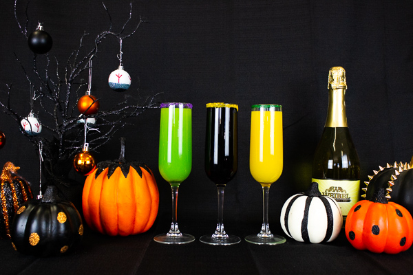 Three halloween themes mimosas displayed with halloween decor