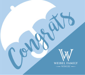 "A label with an umbrella reading ""congrats"""