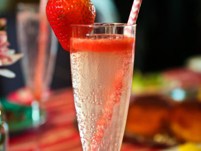 A champagne flute of sparkling strawberry lemonade